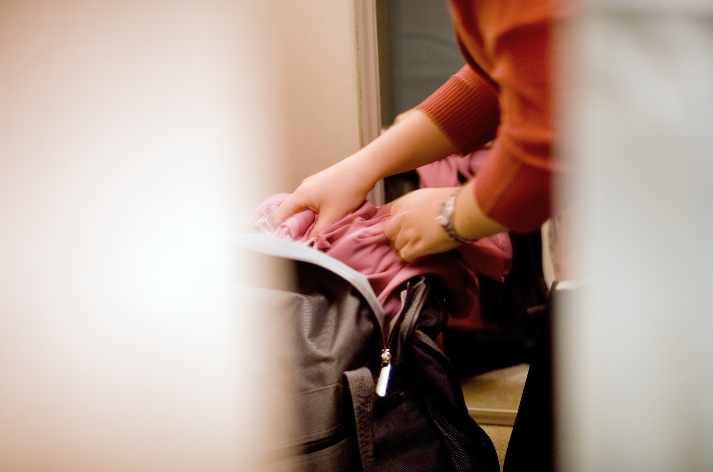 A female in the act of shoplifting or stealing puts an item under her clothes
