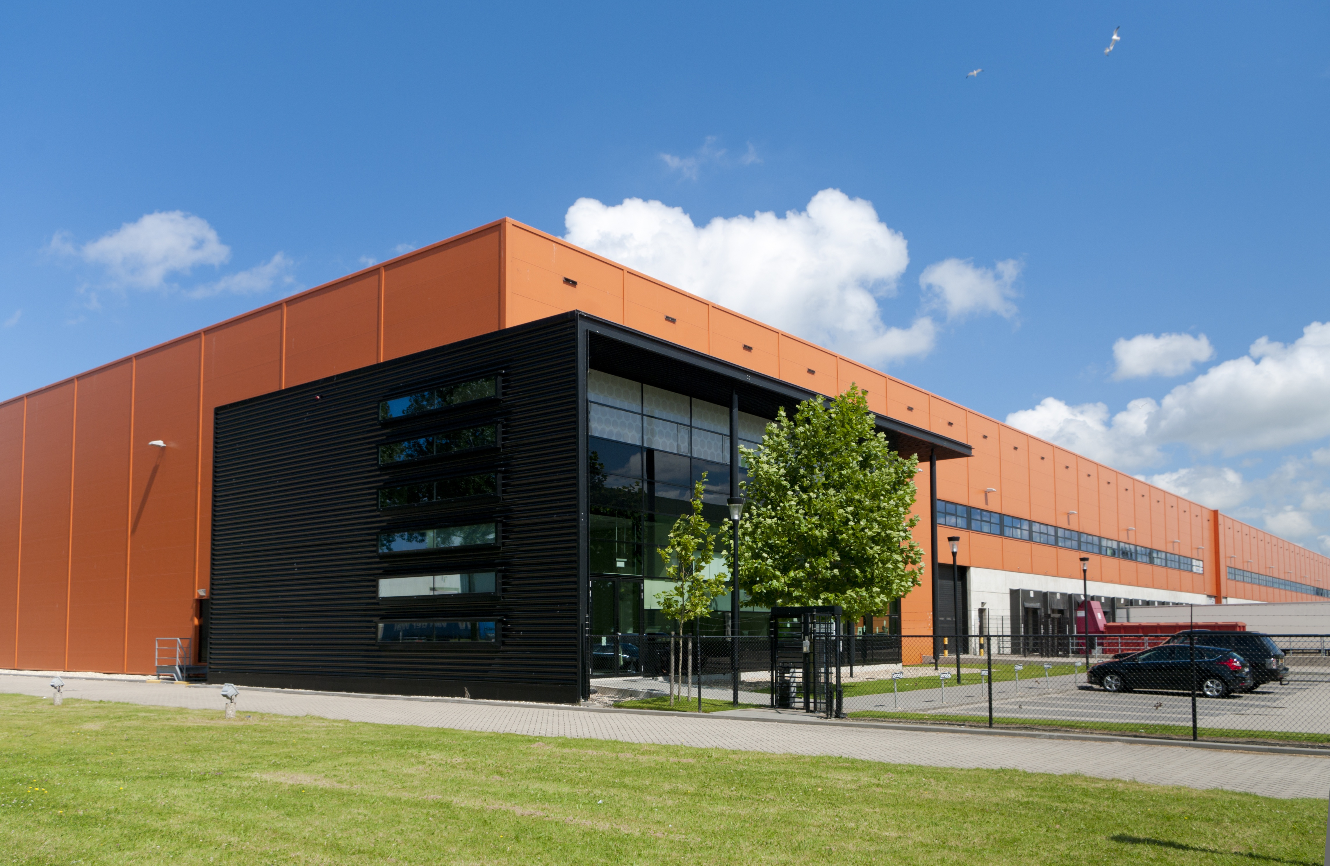 modern orange warehouse in the Rotterdam harbor area